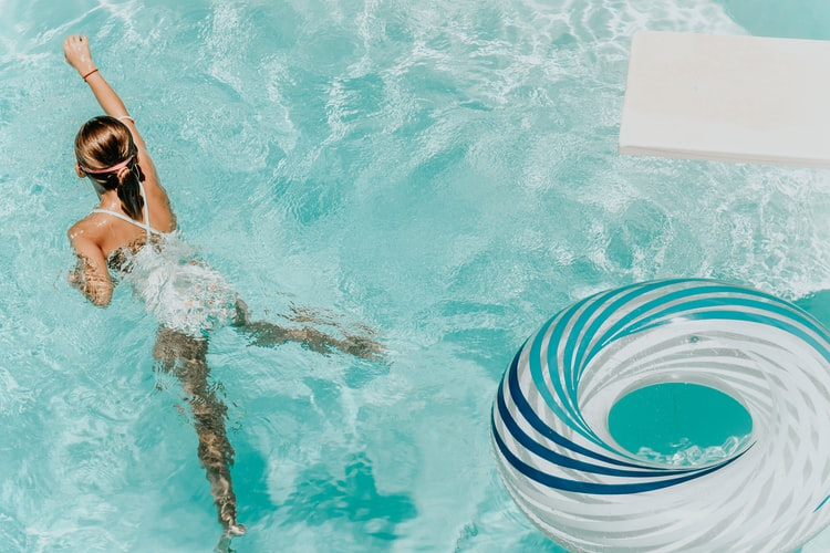 How do you protect your hair and skin while swimming?
